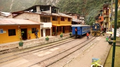 Railroad with a train in Aguas Calientes, Peru - stock footage