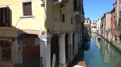 A backwater canal in a quiet part of Venice city Stock Footage