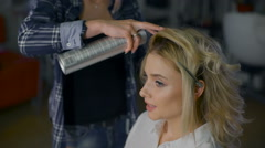 Pleasant business woman with make-up in a beauty salon. Professional hairdresser Stock Footage