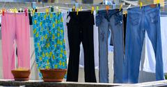 Laundry clothes hanging out to dry Stock Photos