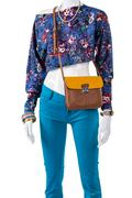 Crop top with bicolor handbag. Stock Photos