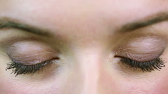Extreme closeup of beautiful green eyes, girl flirting. On reception at oculist Stock Footage