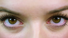 Angry woman screwing up her eyes, extreme close-up. Anxious, nervous person Stock Footage