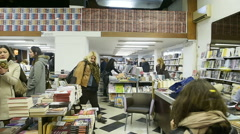 People buying books in bookshops Stock Footage
