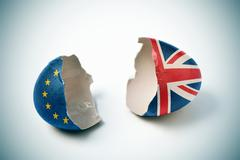cracked eggshell patterned with the European and the British flag - stock photo