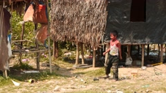 Boy playing a football in a village - Myanmar near Yangon city Stock Footage