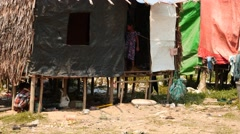 Poor children playing near houses in a Myanmar village Stock Footage