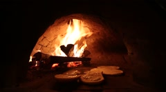 Pizza in a stone stove - stock footage