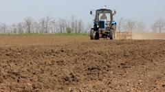 Tractor harrow field - stock footage