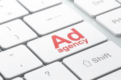 Advertising concept: Ad Agency on computer keyboard background Stock Illustration