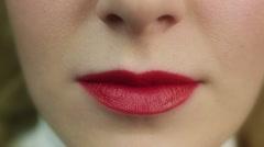 Seductive beautiful female flirting and biting lip. Perfect make-up. Red lips Stock Footage