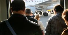 People boarding plane in Stuttgart Stock Footage