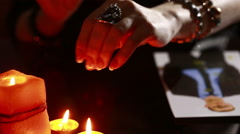 Woman holds a ritual of black magic. spell men. He uses photography Stock Footage
