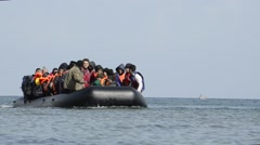 Refugees arriving in Greece in dinghy boat from Turkey. Arkistovideo