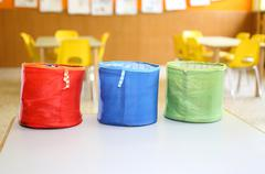 Three colored fabric containers for children's toys in the kindergarten Stock Photos