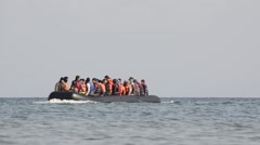 Refugees arriving in Greece in dinghy boat from Turkey. - stock footage