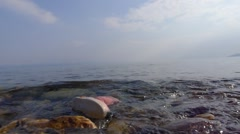 Boot floating in the sea from refugee child Stock Footage