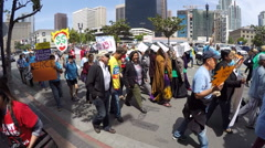 $15.00 per hour crowd of protesters walking by in San Diego - stock footage