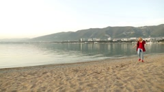 Girl walking on the beach. Girl and sea. Girl having fun in the sea. Stock Footage