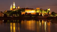 Wawel Hill above Vistula River in Krakow at night Stock Photos