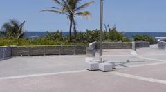 Pan across an oceanfront plaza facing the Atlantic Ocean in Old San Juan. Stock Footage