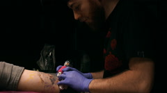 Tattoo master making tattoo. Close up. Slow motion Stock Footage