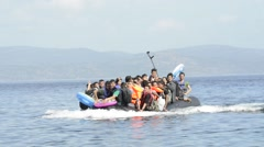 Refugees arriving in Greece in dinghy boat from Turkey. Stock Footage