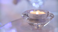 Small burning candle - stock footage