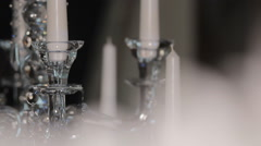 White candles on a crystal chandelier Stock Footage