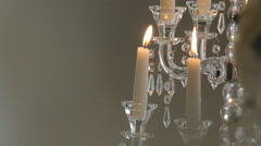 Burning candles on a support and background blur - stock footage