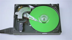 Isolated hard drive from the computer with a green disc - stock footage