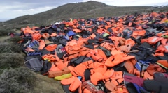 Mountain of Lifejackets left by refugees. Stock Footage