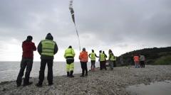 Volunteers at the cliff near Mytilene Stock Footage