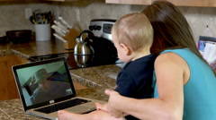 Mother and baby video chat with military father Stock Footage