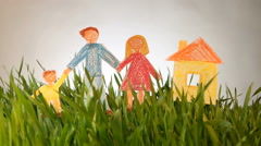 Family and House drawn icon on Grass green summer background. Stock Footage
