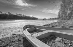 Row Boat by Icy River Stock Photos
