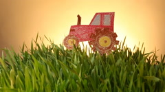 Tractor drawn icon on Grass green summer background. Stock Footage