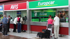 Passengers stand in queue for vehicles hire. Airport of Tenerife island Stock Footage