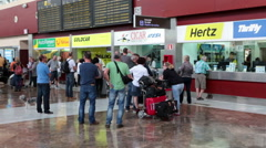 Stands of car rental companies in arrival hall of south airport of Tenerife Stock Footage