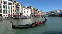 Gondola activity in the approaches to Rialto bridge on the Grand Canal, Venice - stock footage