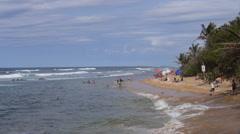 People enjoying Bajamar Beach a hidden beach in Old San Juan Stock Footage