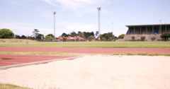 Sportswoman doing long jump Stock Footage