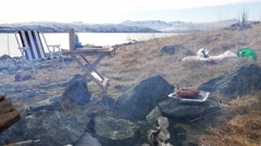 Picnic on the shore of the North Sea. Grilling on a background of mountains. Stock Footage