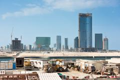 Abu Dhabi new district with skyscrapers construction - stock photo