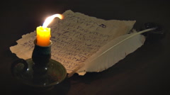 Ancient Manuscript and Burning Candle - stock footage