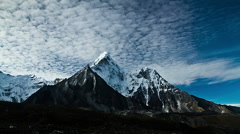Time lapse of cloudscape and snowcapped mountain, Chukhung, Nepal Stock Footage