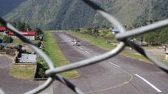 Aeroplane landing on runway in Dingboche - stock footage