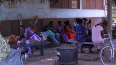 Locals people sitting on bench in Ghana - stock footage