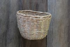 Basket weave of handicraft on old wooden. Stock Photos