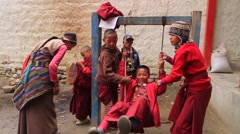 Children playing on swing in Mustang Stock Footage